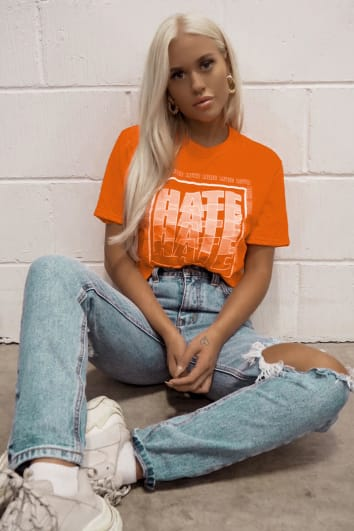 LOTTIE TOMLINSON ORANGE HATE SLOGAN CROPPED T SHIRT