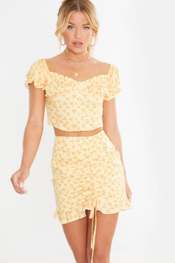 yellow abstract polka button crop top and mini skirt