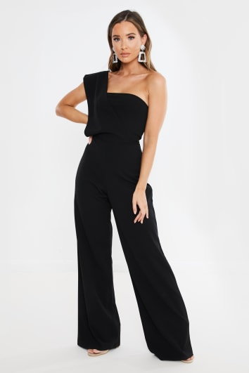 INAAYA BLACK DRAPE ONE SHOULDER JUMPSUIT