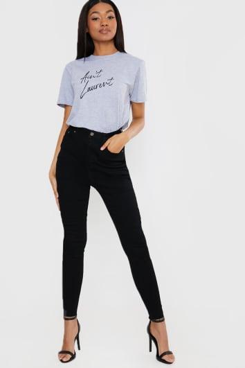 black distressed hem skinny jeans