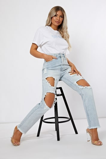 light blue extreme distressed rip jeans