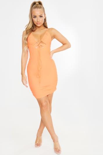 orange slinky cut out ruched mini dress