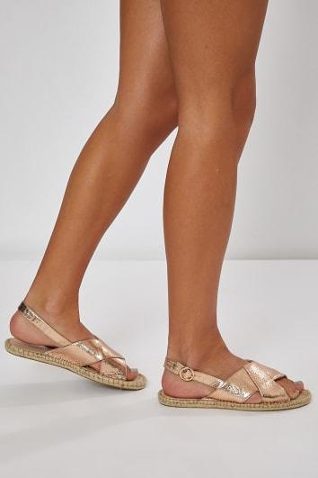 rose gold faux suede cross strap sandals