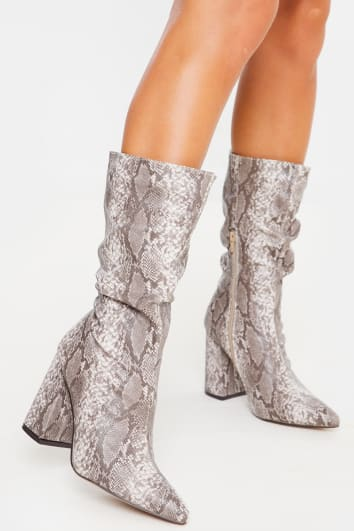 JISELLE SNAKE PRINT RUCHED CALF HEELED BOOTS
