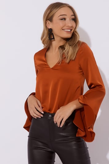 rust v neck satin frill blouse