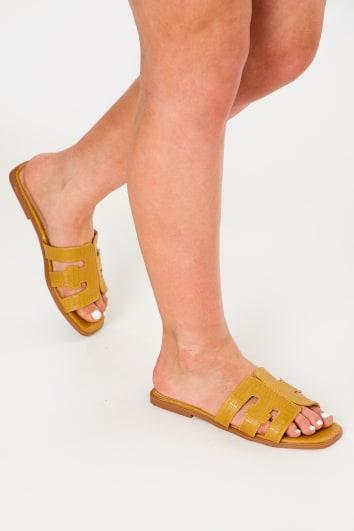 yellow croc sliders