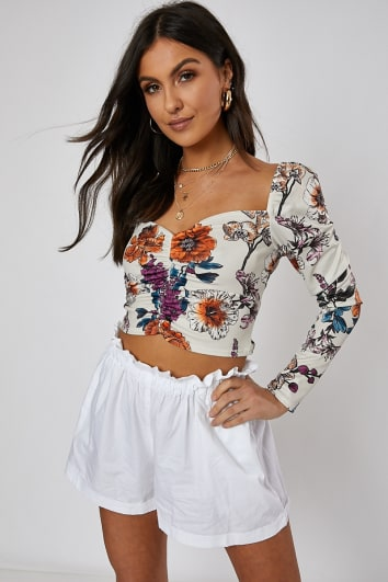 nude floral ruched front long sleeve crop top