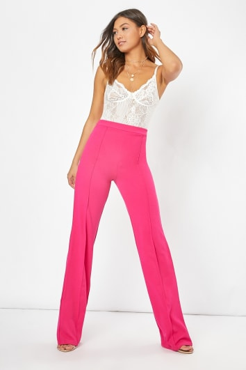pink stitch detail straight leg trousers