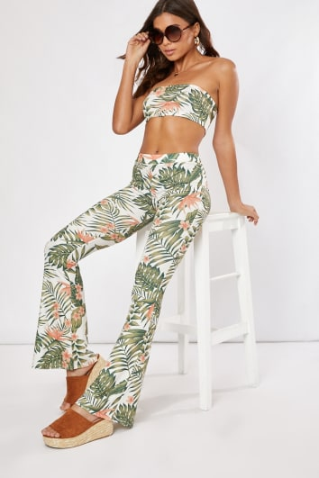 white tropical print flared co-ord trousers