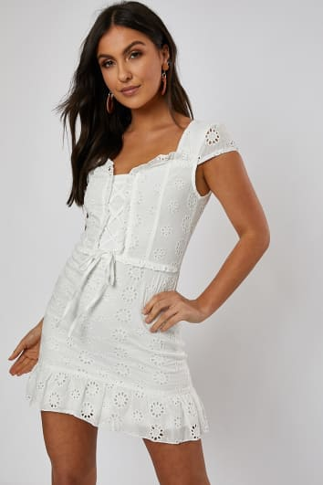 white broderie frill hem belted mini dress