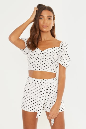 white polka dot puff sleeve crop top and shorts co ord