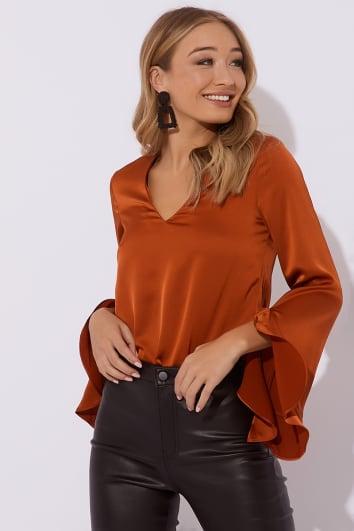 rust v neck satin frill blouse