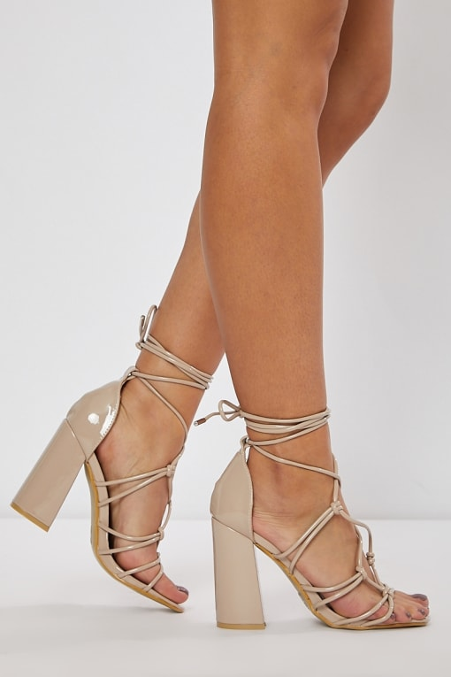 NATIVIA NUDE LACE UP BLOCK HEELS
