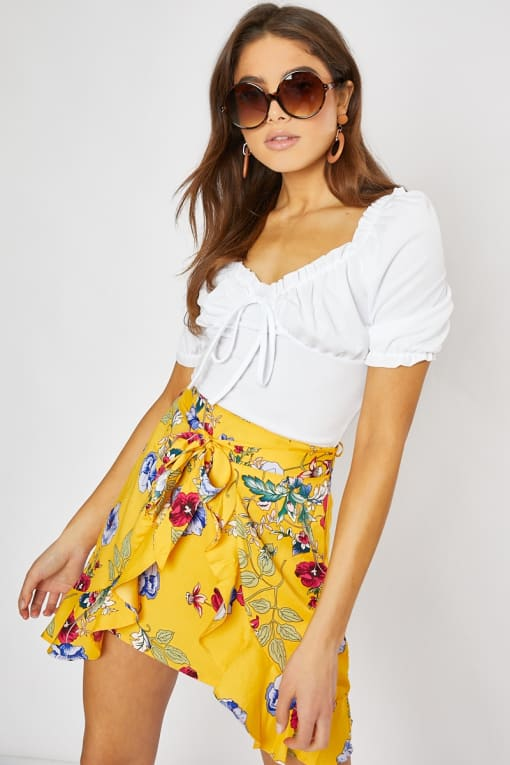 yellow floral tie front mini skirt