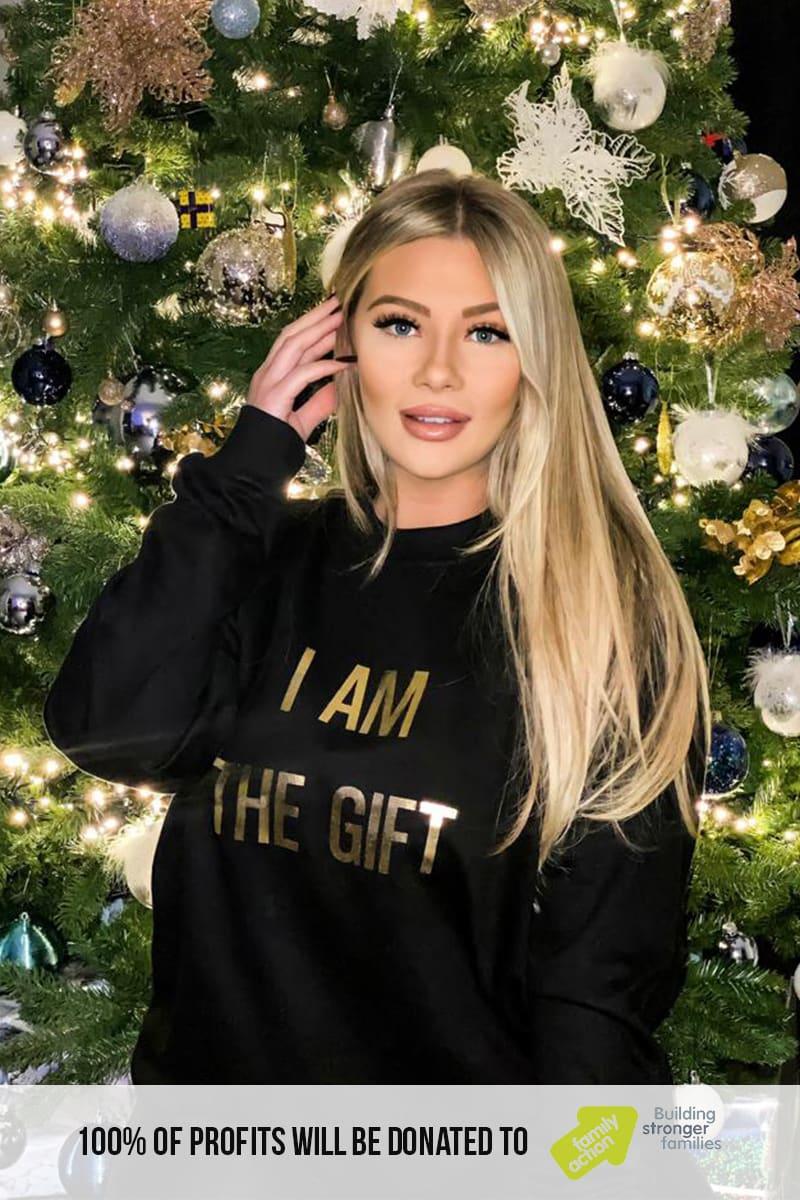 "SHAUGHNA PHILLIPS BLACK ""I AM THE GIFT"" CHRISTMAS SWEATSHIRT"