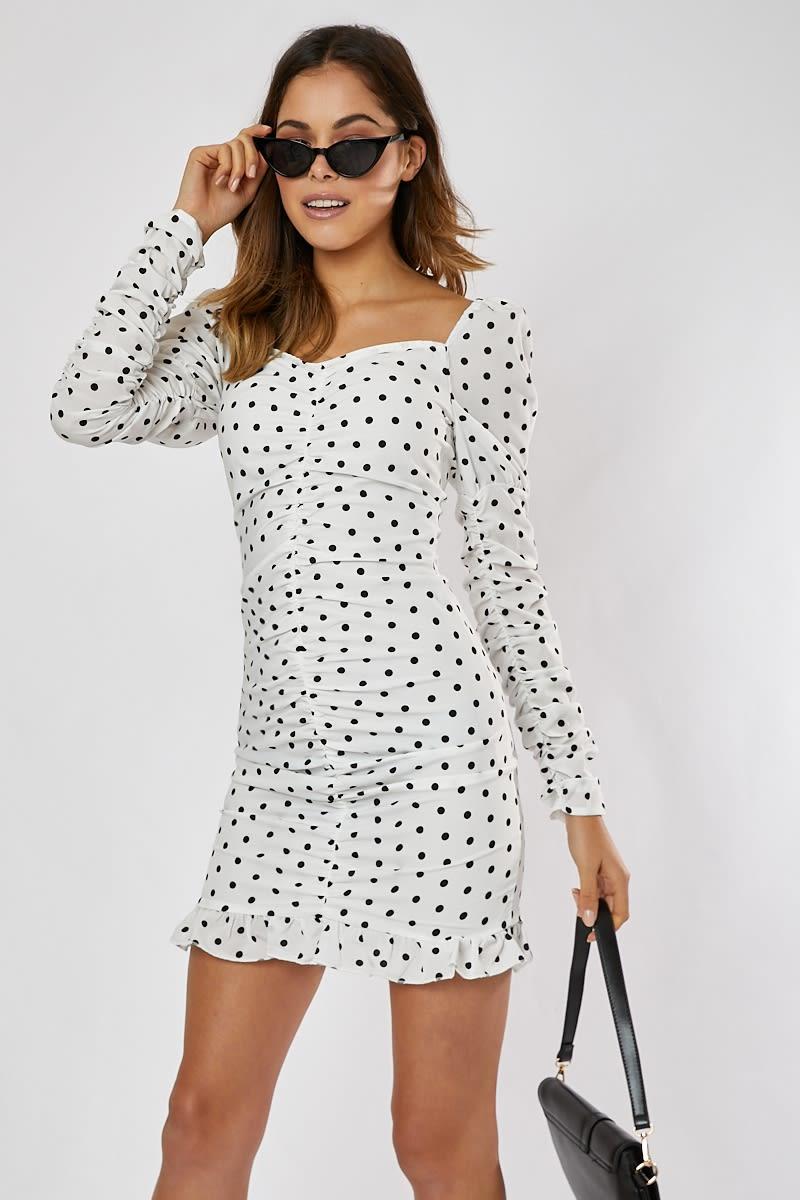 white and black polka dot puff sleeve ruched frill hem mini dress