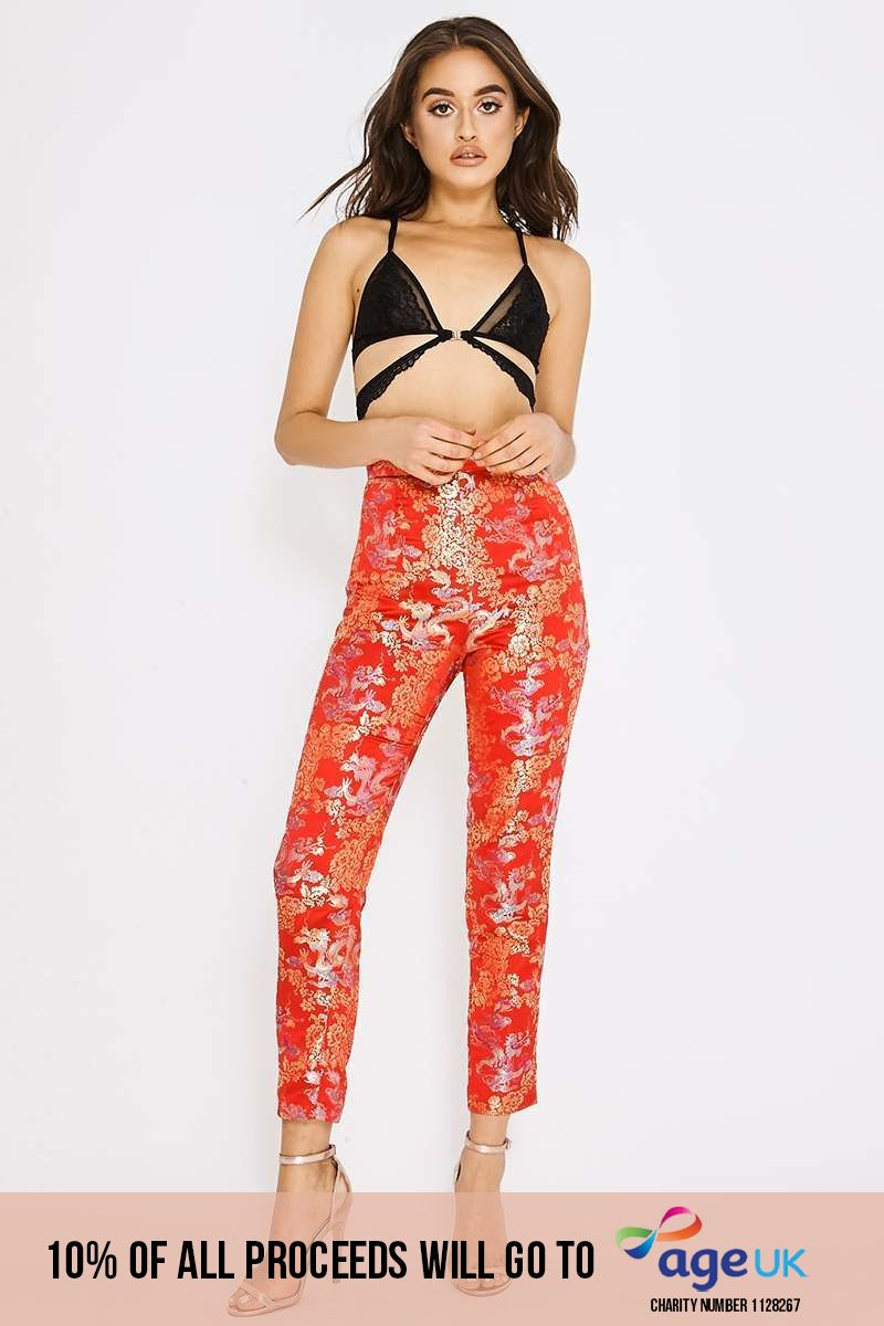 red tapered oriental jacquard trousers
