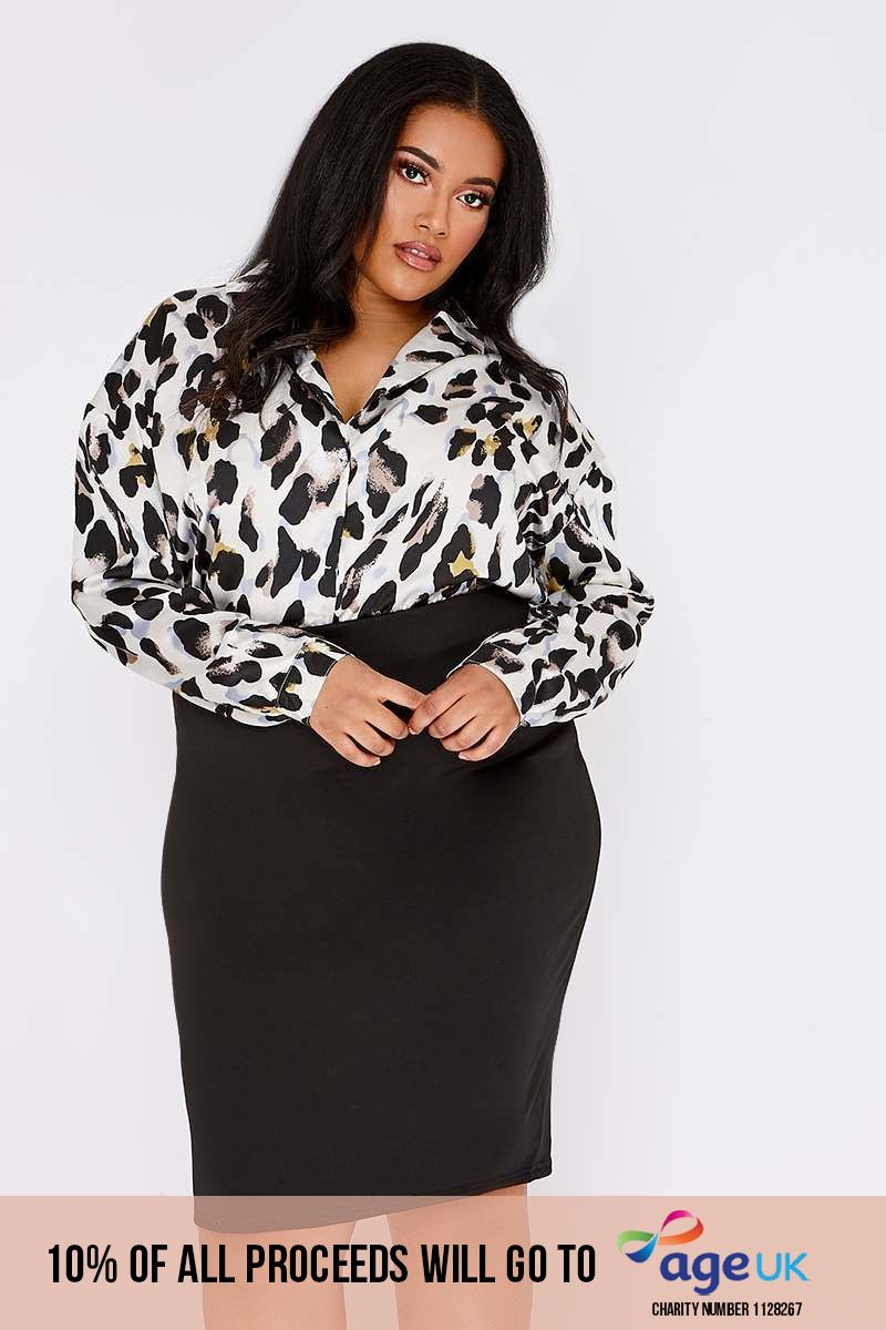 CURVE BUFFY BLACK MIDI SKIRT