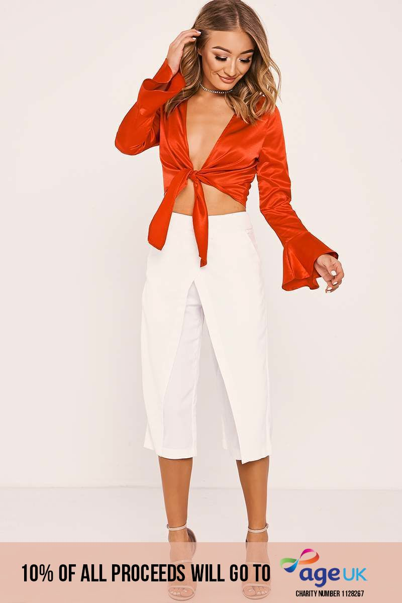 white overlay cropped trousers