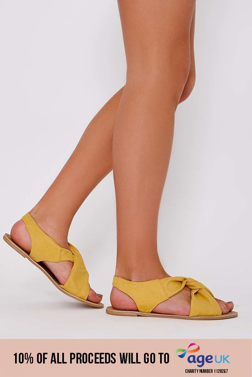 HANIA YELLOW FAUX SUEDE TWIST STRAP SANDALS