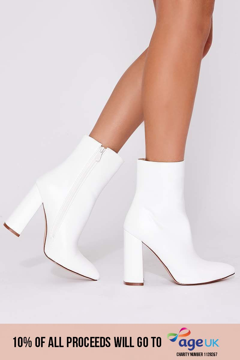 white faux leather heeled ankle boots