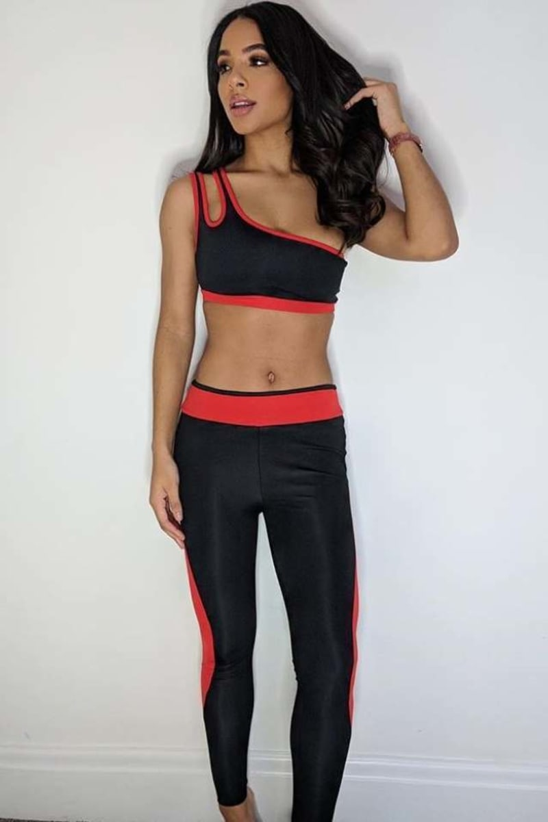 CHARLOTTE CROSBY BLACK AND RED ONE SHOULDER SPORTS BRA