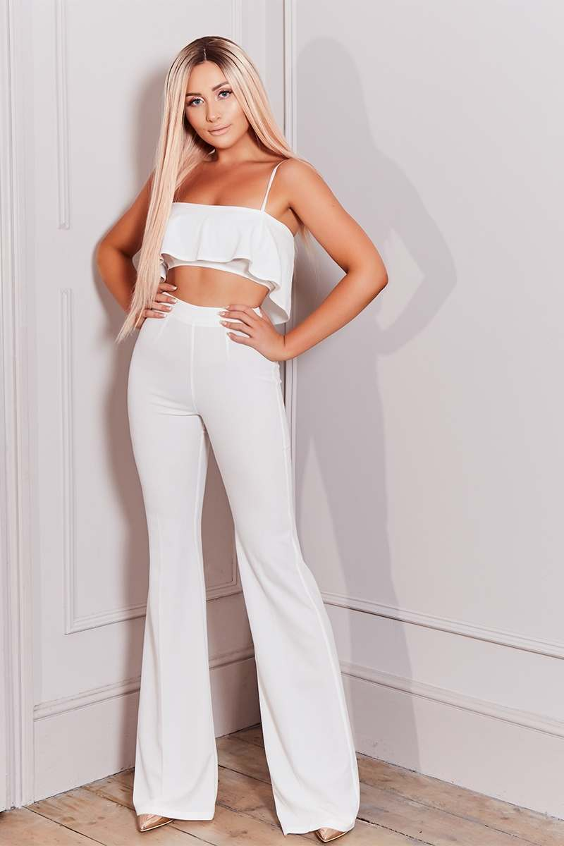 white tall high waisted wide leg trousers
