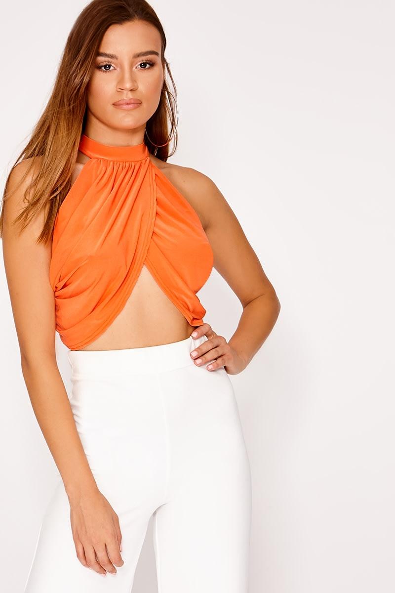 orange halterneck wrap front crop top