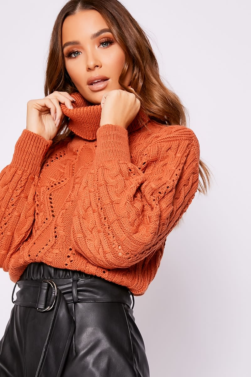 rust roll neck cable knit jumper