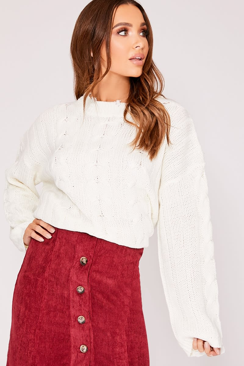 white knitted distressed jumper