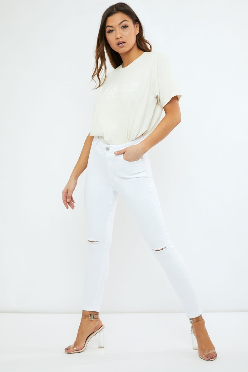 white high waist skinny jeans with slash knee