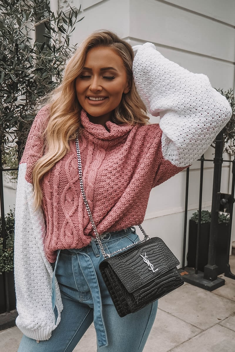 pink and white cable knit jumper