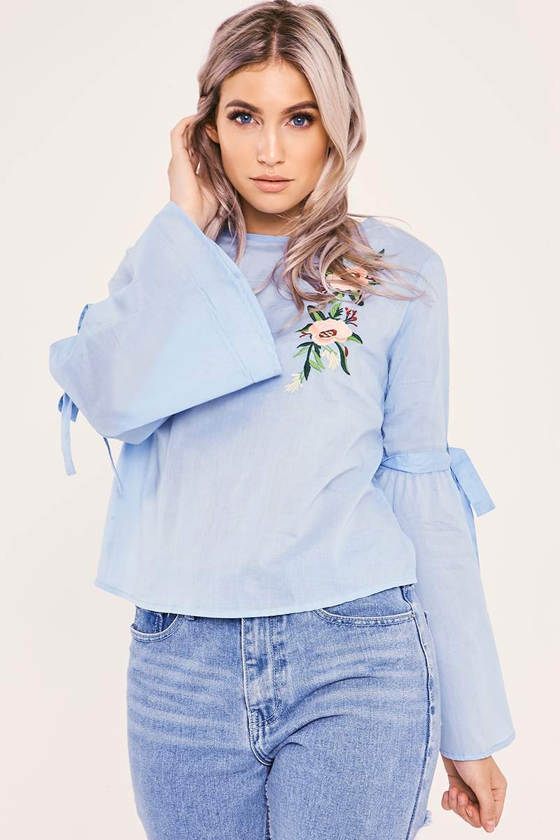 blue floral embroidered flared sleeve top