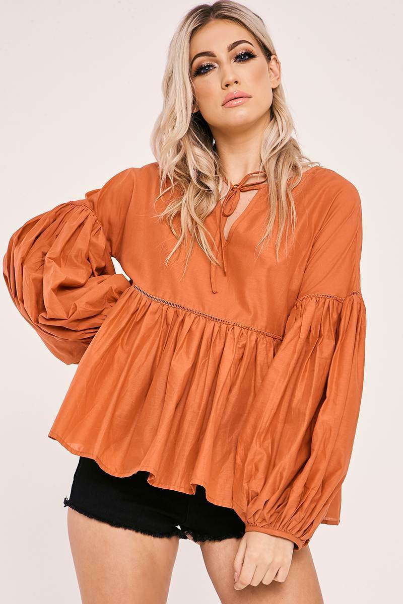 orange tie front balloon sleeve top