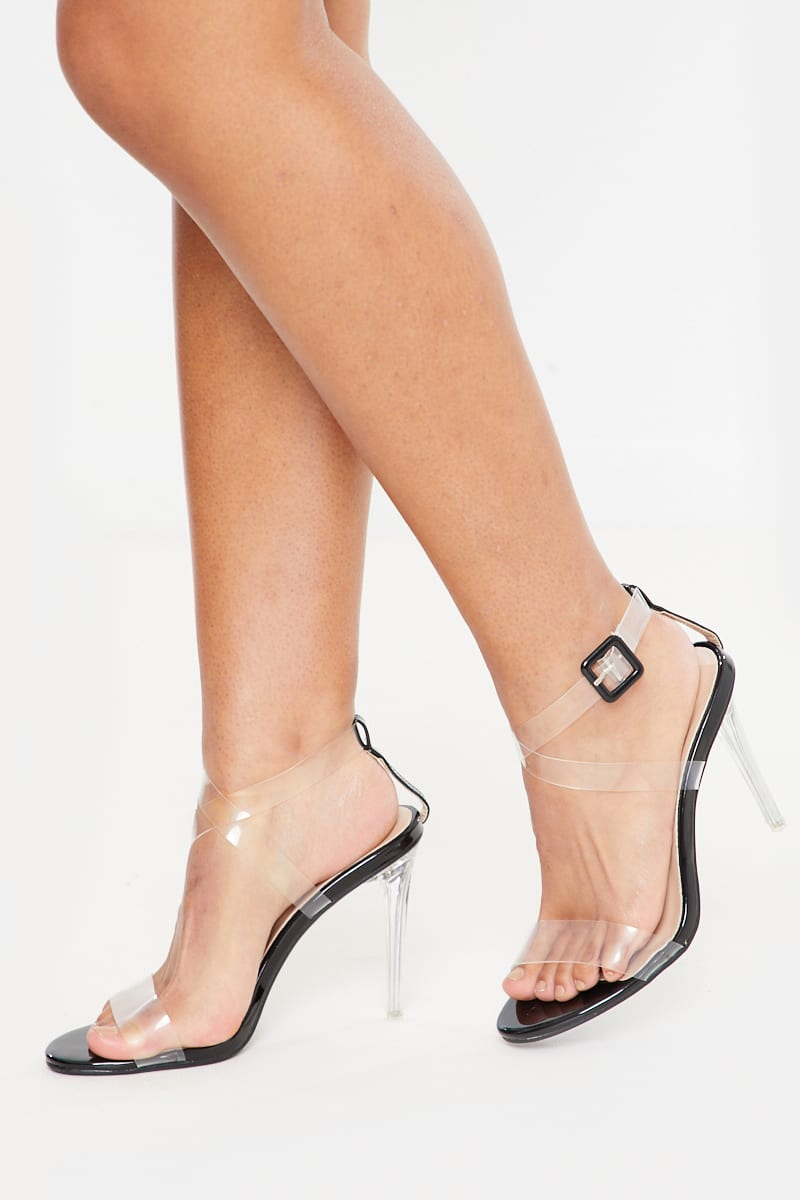 black cross over strap buckle detail perspex heels
