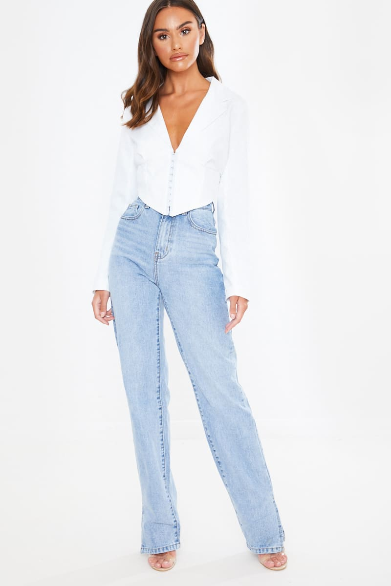 light wash denim split hem straight leg jeans