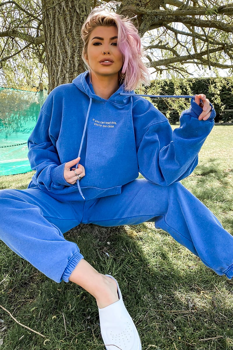 "OLIVIA BOWEN WASHED BLUE ""YOU'RE TOO CLOSE"" SLOGAN HOODIE"