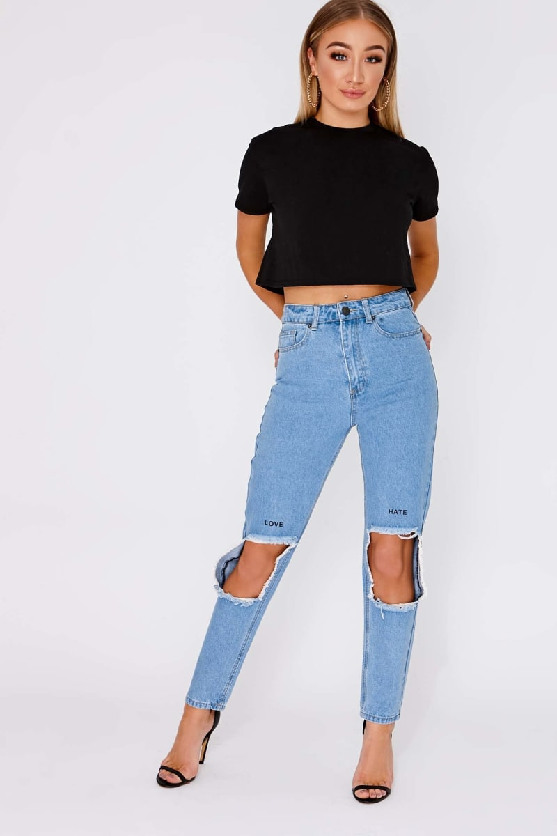 HANAE MID WASH RIPPED SLOGAN MOM JEANS