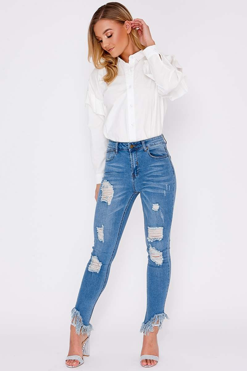 light blue frayed distressed skinny jeans