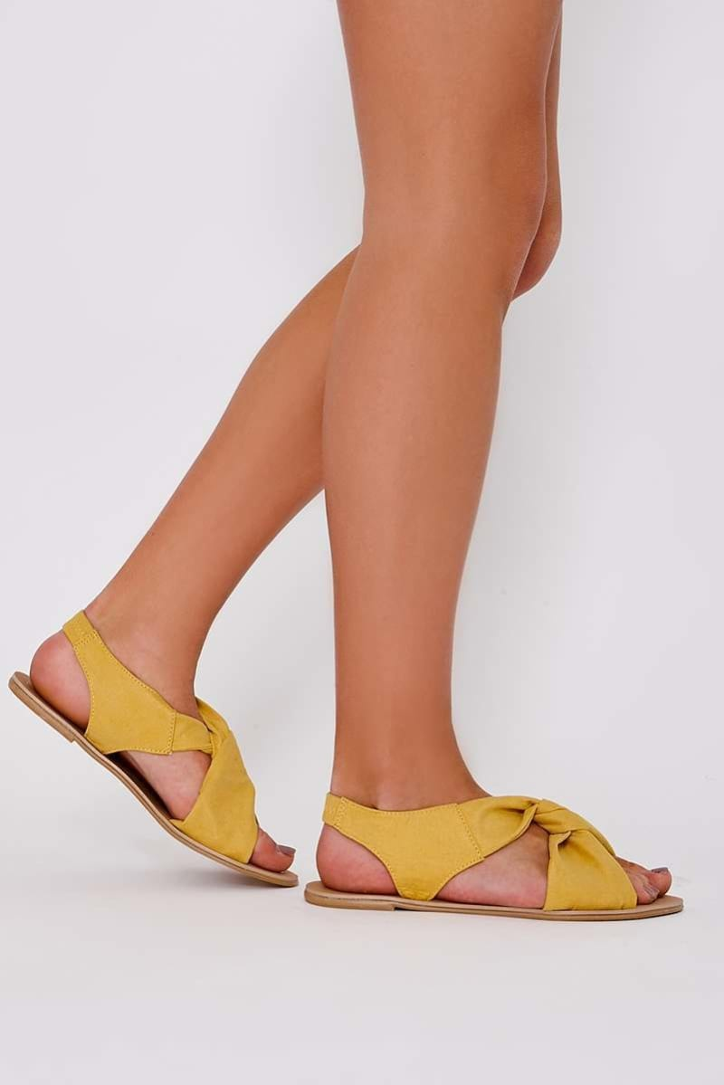 yellow faux suede twist strap sandals