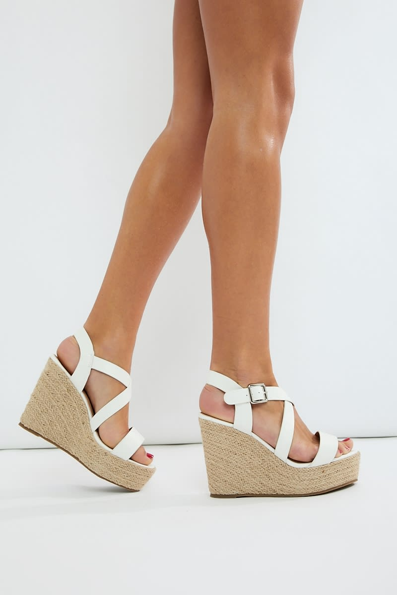 white cross strap wedges