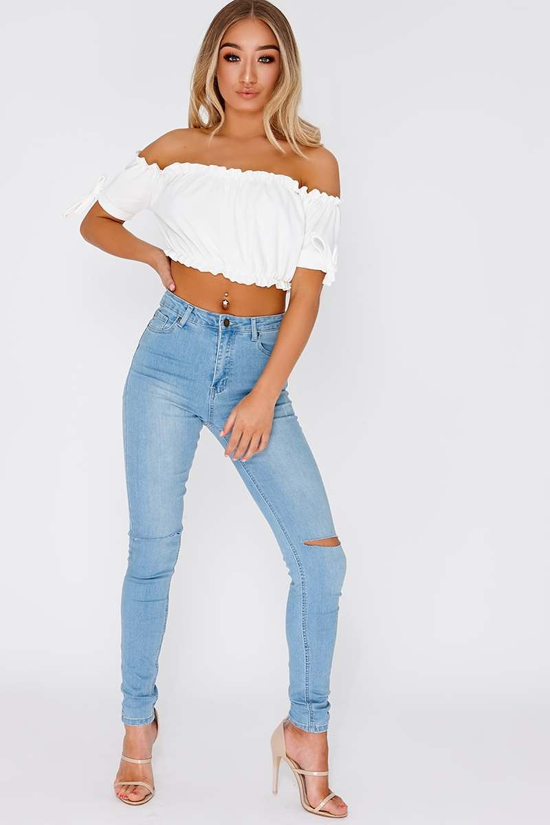 light wash ripped knee high waisted skinny jeans