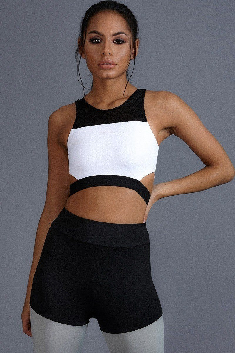 CHARLOTTE CROSBY WHITE AND BLACK CUT OUT MESH PANELLED SPORTS BRA