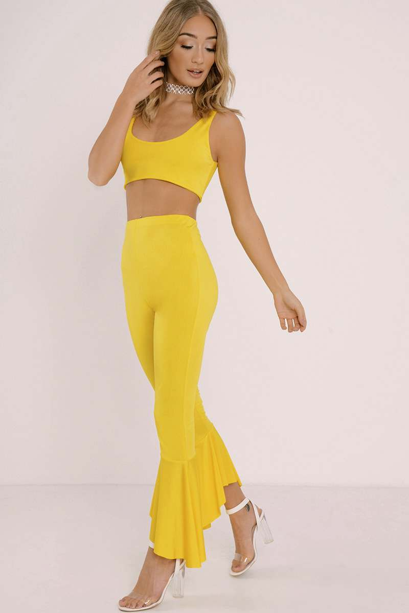 KELCIE YELLOW SLINKY FRILL HEM TROUSERS