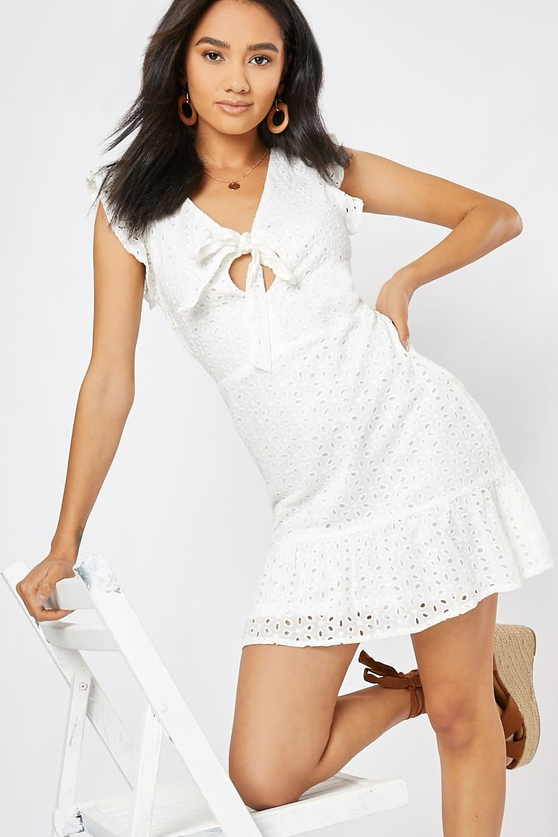 white broderie anglaise tie front frill mini dress