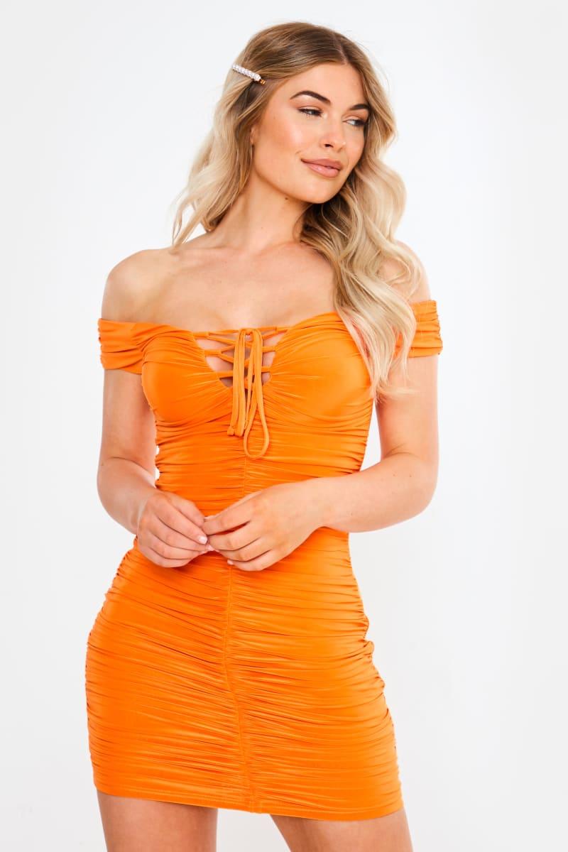 orange slinky bardot ruched mini dress