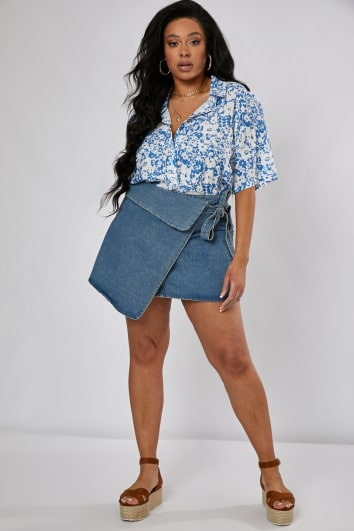 CURVE LAURA JADE LIGHT WASH ASYMMETRIC WRAP MINI SKIRT