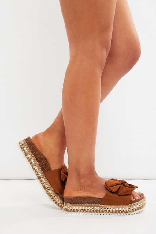 KYLEEN TAN FAUX SUEDE BOW DETAIL SLIDERS