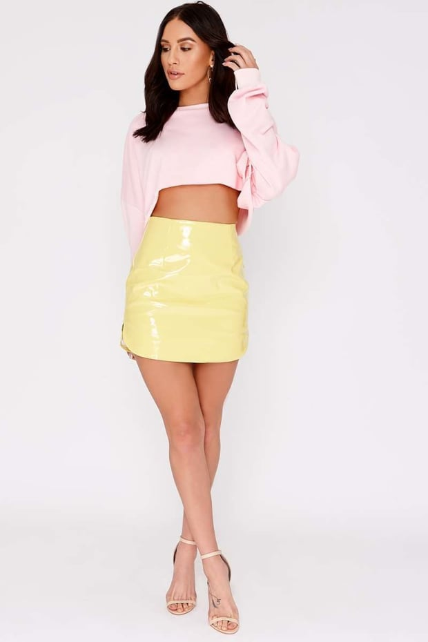 CHARLOTTE CROSBY LEMON VINYL CURVED HEM MINI SKIRT