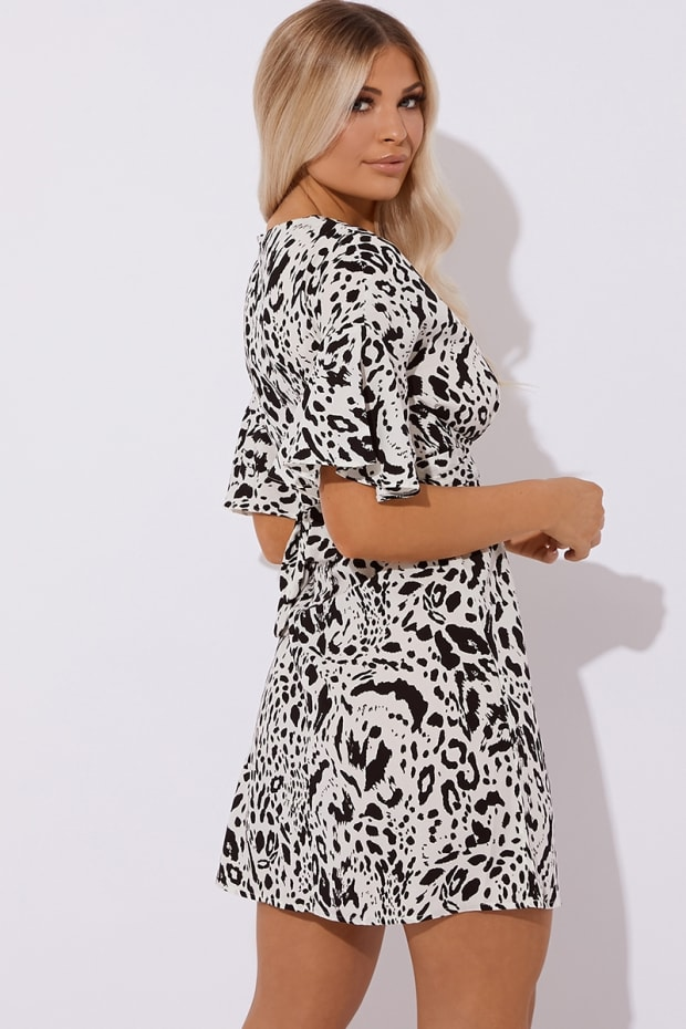 70227e4b04e KAILANI WHITE LEOPARD PRINT MINI DRESS. Play Hide